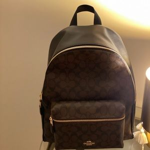 A spacious, functional coach backpack.